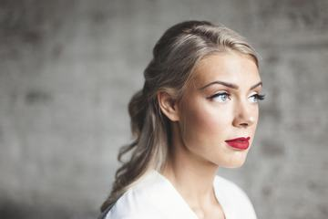 Portrait of Caucasian Blonde Woman with red Lips and Artificial Eyelashes