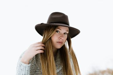 Girl Wearing a Knitted Sweater and a Dark Hat