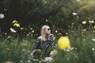 Pensive Woman in Meadow
