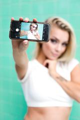 Blonde Girl Showing Selfie on Her Smartphone