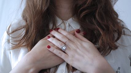 Woman with Red Nails and Silver Rings