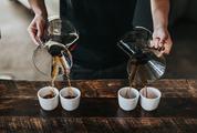 Professional Barista Serves Hand Brewed Coffee