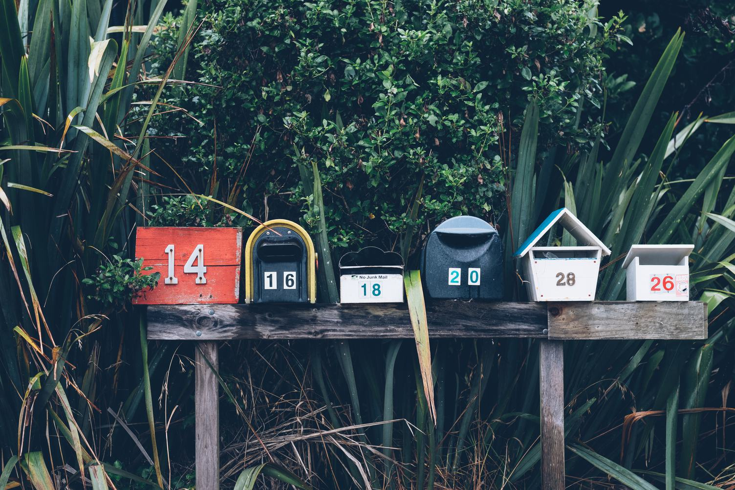 Six Various Mailboxes Different Colors and Shapes