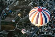 Hot Air Balloons over a City