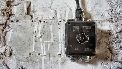Electrical Junction Box against a Concrete Wall