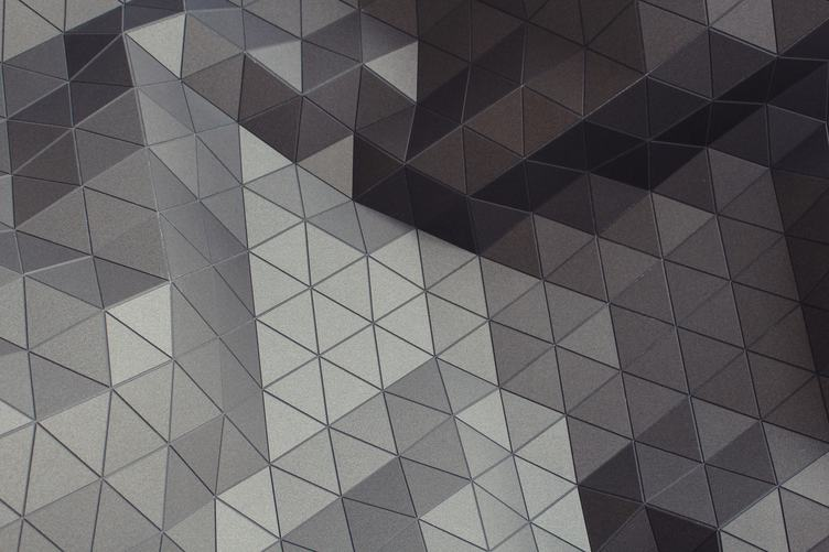 Abstract Closeup View of Modern Gray Triangles on Facade
