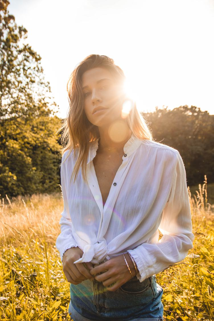 Beauty Romantic Girl Portrait against the Sun