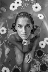 Beautiful Young Woman Having Bath with Flowers