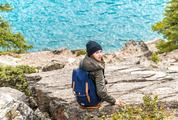Girl Traveler with Backpack Enjoying View