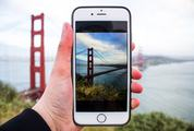Person Taking Picture with iPhone of the Golden Gate Bridge