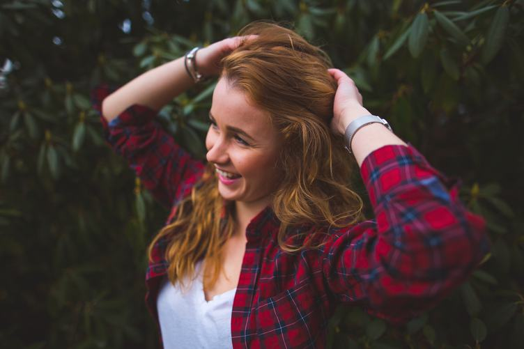 Portrait of a Happy Redhead Girl in Plaid Shirt