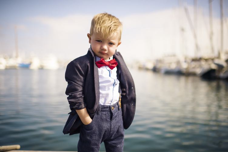 Little Boy Wearing Elegant Jacket with Red Bow Tie