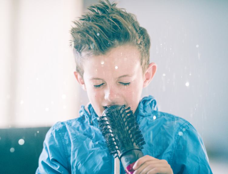 Little Boy Singing Using a Hairbrush as Microphone