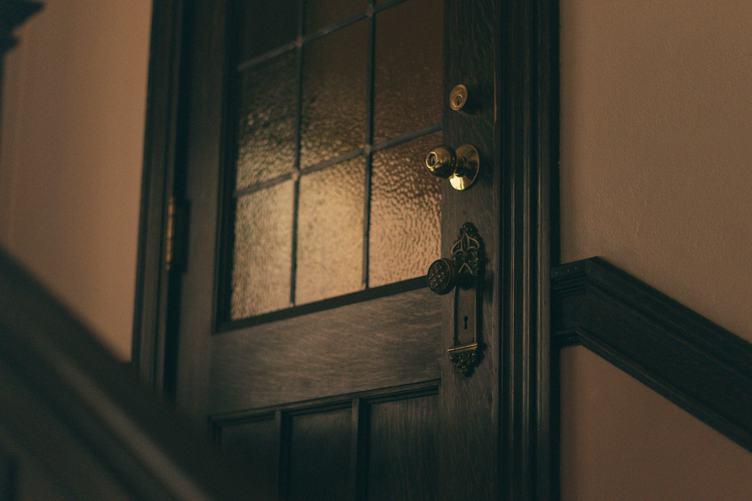 Closed Wooden Door In the Dark Corridor