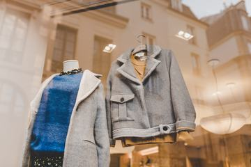Boutique Window with Hangers and Gray Jackets