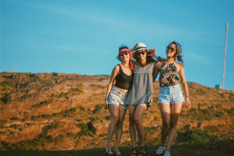 Three Joyful Young Girls on Summer Trip