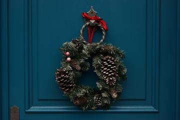 Christmas Wreath Hanging on Turquoise Wooden Door