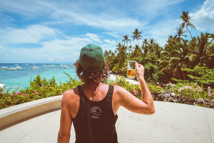 Young Man Drinking Beer Enjoying View
