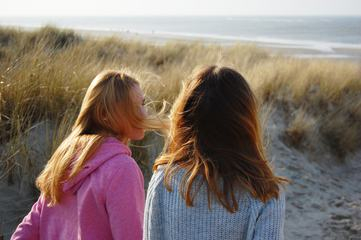 Two Girls Sitting on the Dune
