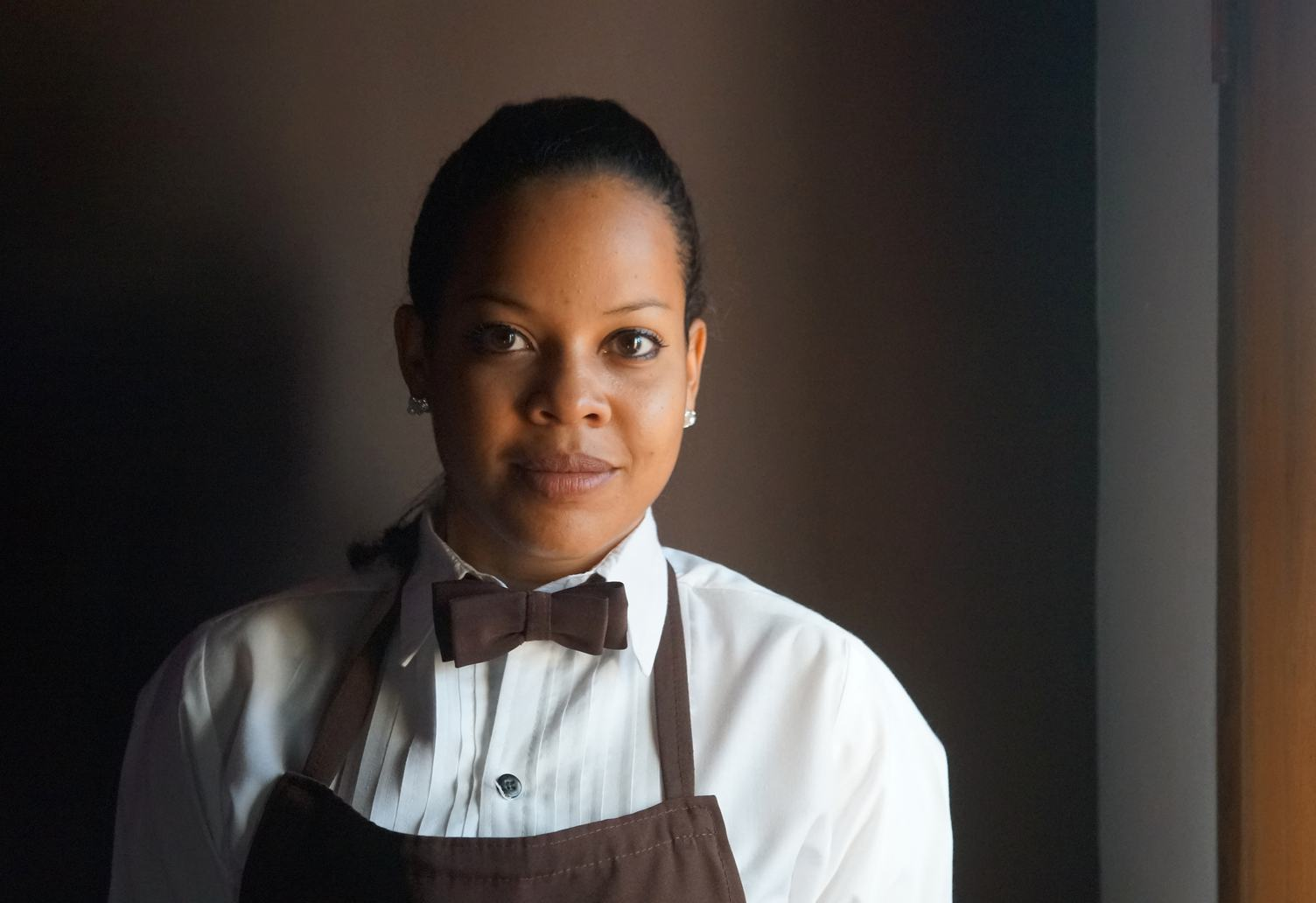 Portrait of Standing Waitress