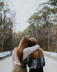 Back View of Two Girls Hugging