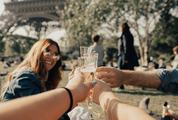 Friends Drink Champagne near Eiffel Tower