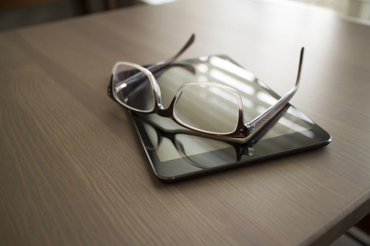 iPad and Glasses on Wooden Table