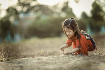 Little Asian Girl Playing with Sand