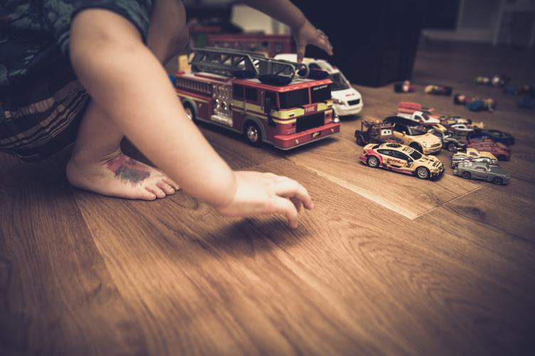 Boy Playing with His Cars