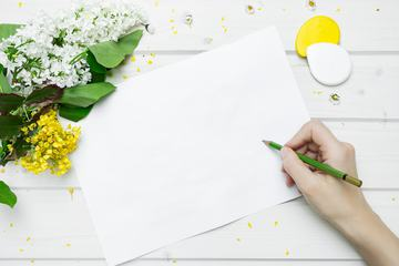 Blank Paper Card and Flowers on White Wooden Table