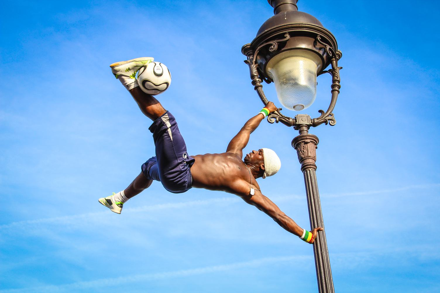 Iya Traore Hanging on Lamp Post with Ball