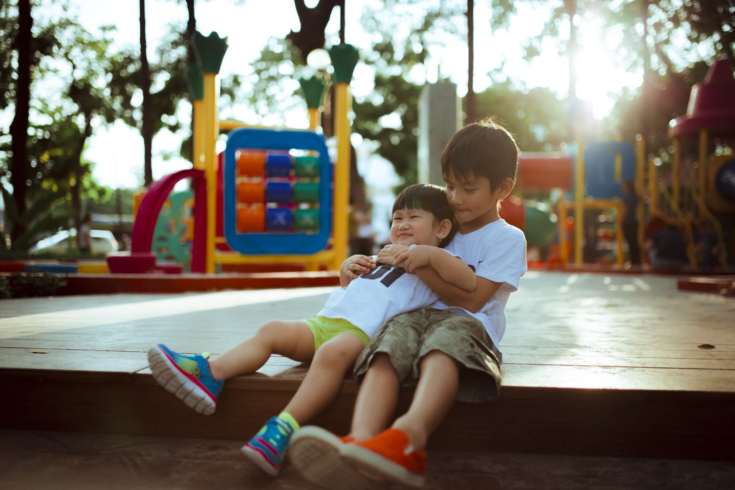 Two Asian Boys Playing Outdoors