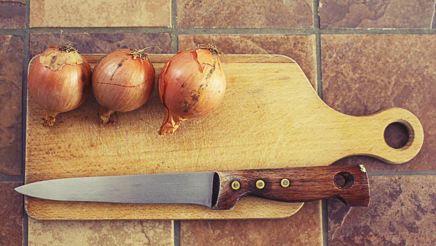 Onions on Wooden Cutting Board