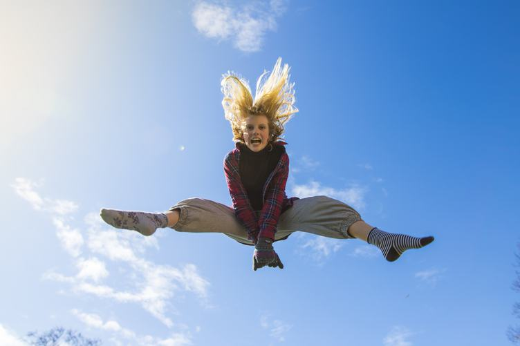 Young Girl Jumping High