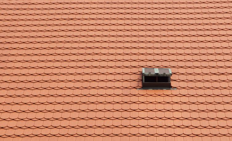 Red Tile Roof with Small Window