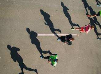 Marathon Runners and Their Shadows