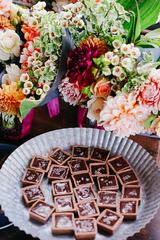 Bouquet of Flowers and Chocolates on the Table
