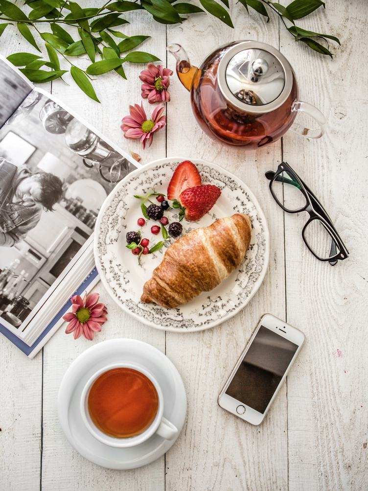 Breakfast Composition with Book, Croissant and Tea