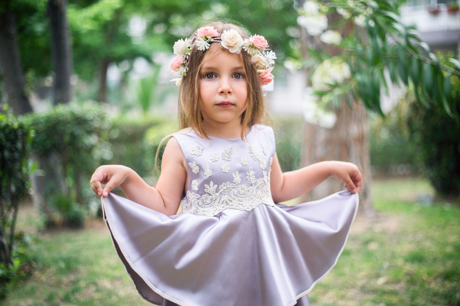 Cute Little Girl with Flower Wreath and Satin Dress