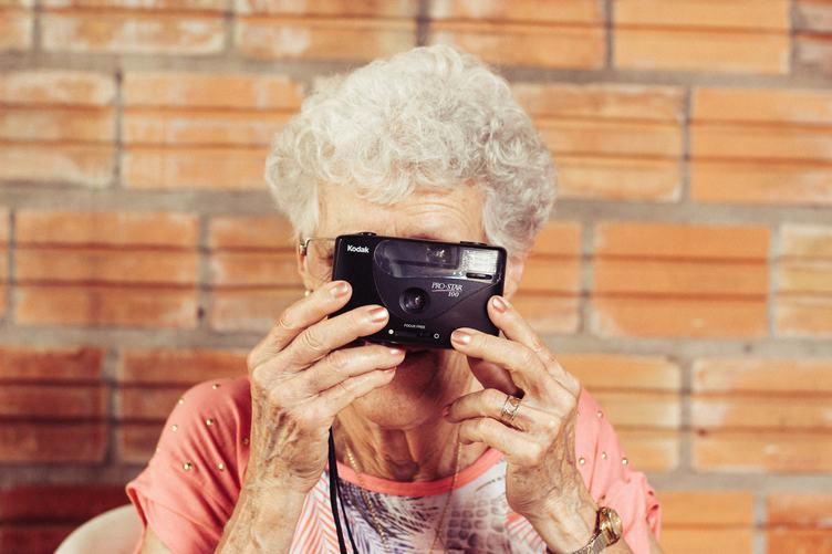 Old Lady Taking a Picture with Her Analog Camera