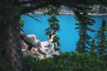 Girl Pointing at Moraine Lake Canada