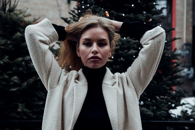 Portrait of Woman in White Coat