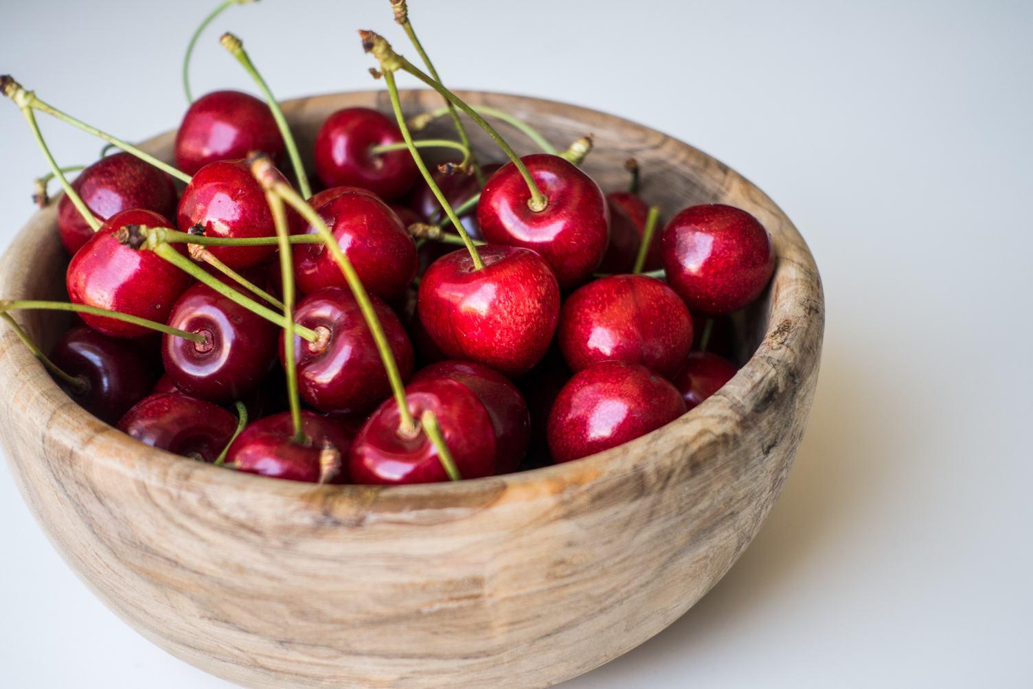 Wooden Bowl full of Fresh Cherries