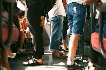 People Standing on the Bus