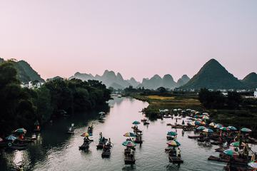 Bamboo Boats with Umbrellas Rafting the Yulong River