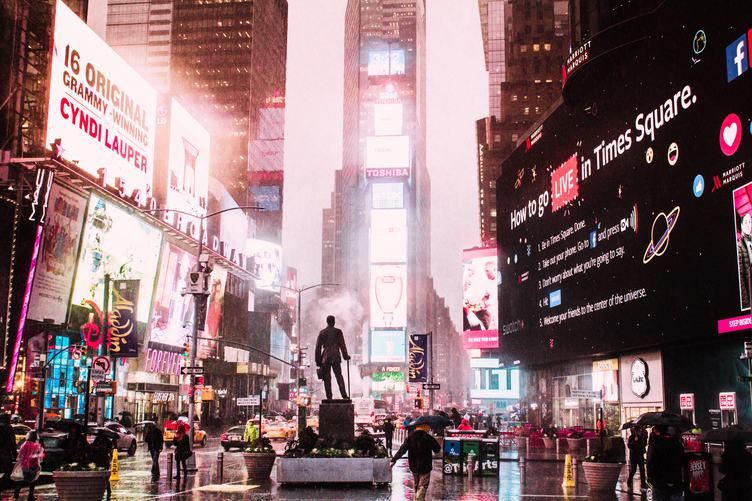 Times Square on rainy night.