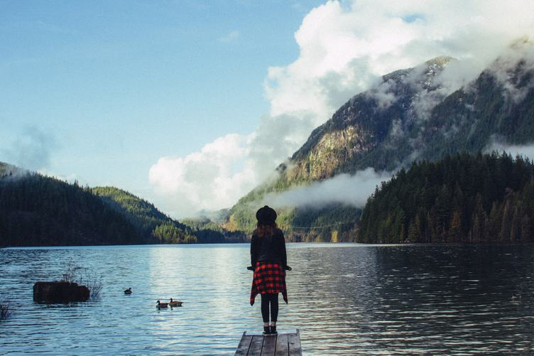 Young Woman Stands on a Wooden Pier, Buntzen Lake, Canada