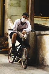 Asian Guy on the Bike