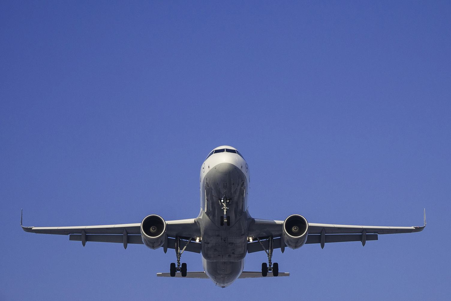 Plane against Blue Sky