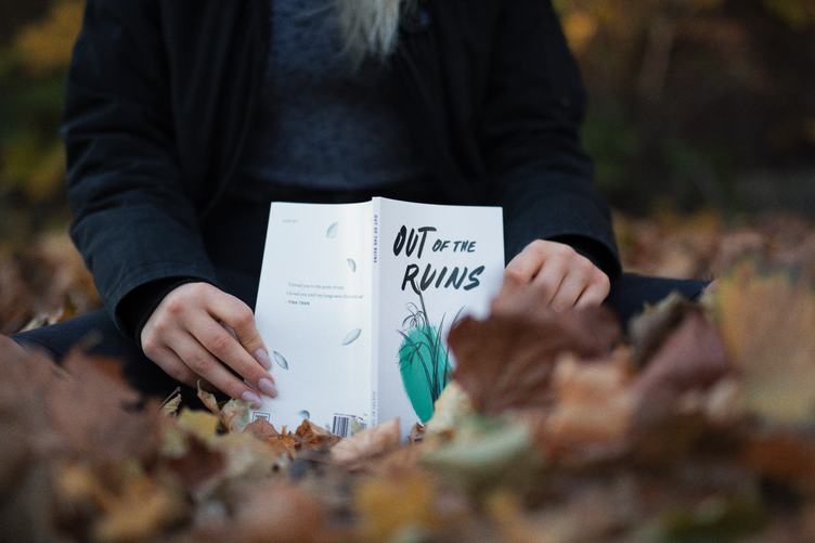 Closeup of Female Hands with Book Outdoors